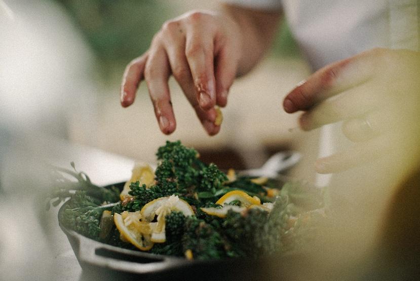 Hands mixing salad